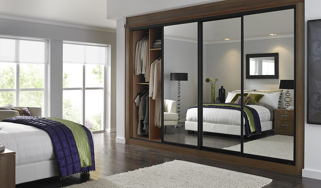 Bedroom with a mirrored fitted wardrobe
