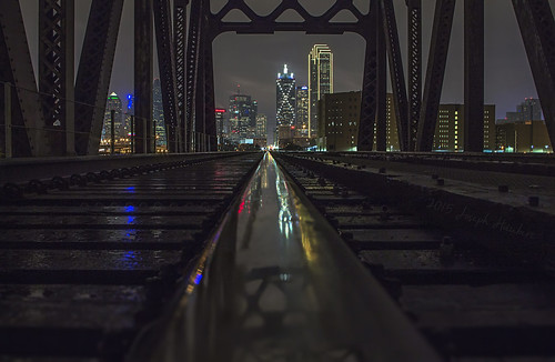 bridge reflection dallas traintracks bridges reuniontower dallastx bankofamericaplaza downtowndallas dallasskyline yahooweather industrialbridge rainreflection josephhaubert dartdallas