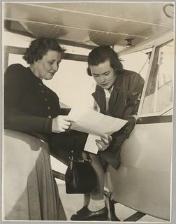 Marie Richardson and Grace Cavanagh next to an Auster monoplane at Bankstown Aerodrome during the second Australian Women Pilots' Association Reliability Trials, Sydney, September 1954