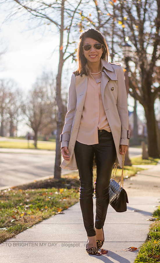 trench coat, peach silk blouse, faux leather pants, leopard flats