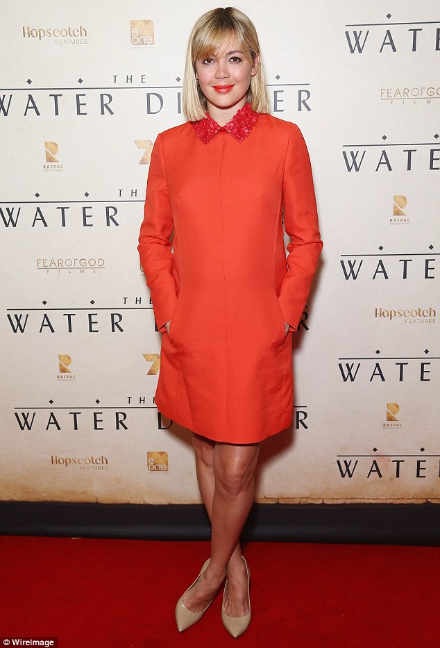 Emma-Lung-in-orange-shift-dress,open-front jumpsuit , orange open-front jumpsuit , long sleeved cropped turtle neck top
