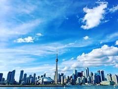 Toronto downtown from Toronto Island's ferry.   #toronto #torontodowntown #downtown #downtowntoronto #cntower #bluesky #blueskies #rogerscentre #torontoIsland #hanlanpoint #lakeOntario #hanlanpointbeach #iphone6S