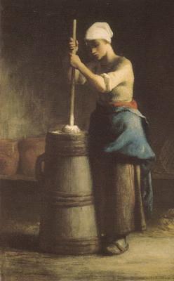 バターをかき回す若い女