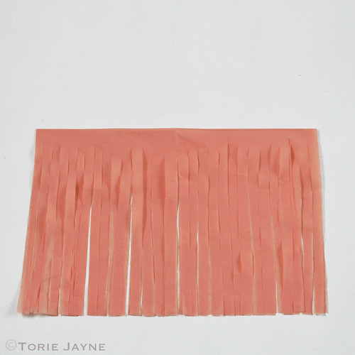 Tissue paper tassel garland tutorial 4