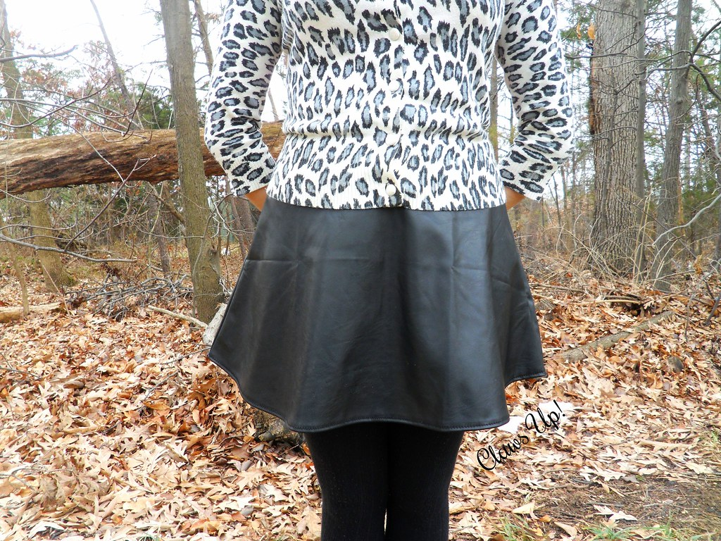 White leopard print cardigan, and faux lather skirt