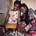 Florence and Diana play chess ikaaya girls' club in northern Kampala