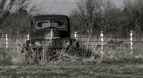 winter sky abandoned grass fence rust pickuptruck oxidation weathered derelict baretrees fadedpaint exposedmetal