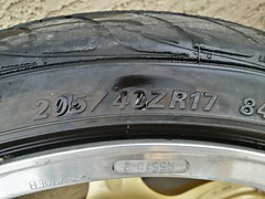 automotive exterior(0.0), bumper(0.0), tire(1.0), automotive tire(1.0), wheel(1.0), synthetic rubber(1.0), tread(1.0), rim(1.0), alloy wheel(1.0),