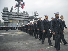 Sailors prepare to man the rails aboard USS George Washington (CVN 73) Nov. 25 as the ship returns to Fleet Activities Yokosuka. (U.S. Navy/MC3 Chris Cavagnaro)