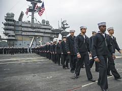 Sailors prepare to man the rails aboard USS George Washington (CVN 73) Nov. 25 as the ship returns to Fleet Activities Yokosuka. (U.S. Navy/MC3 Chris Cavagnaro)