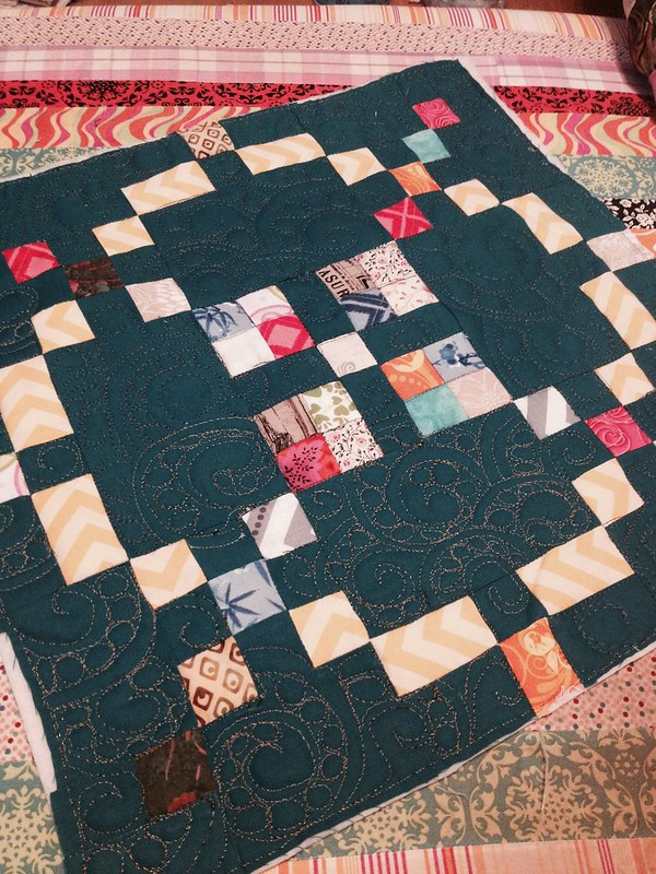 Ornate escargot quilted block
