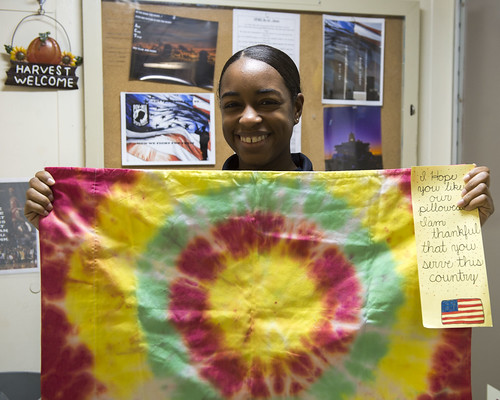 ARBIAN GULF - Mass Communication Specialist 2nd Class Stacy Atkins Ricks, from Detroit, Michigan, poses with a handcrafted pillowcase sent by members of the Heads at Ease Pillowcase Project, an organization that makes and mails pillowcases for deployed service members.