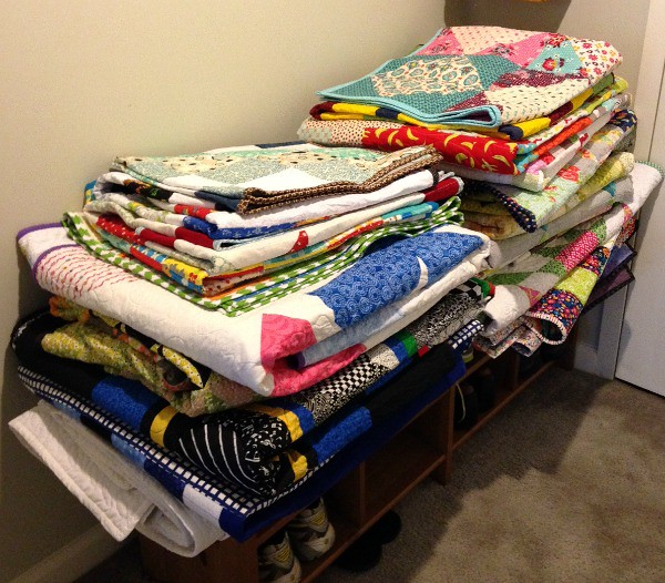 Stack of quilts for 100 Quilts for Kids