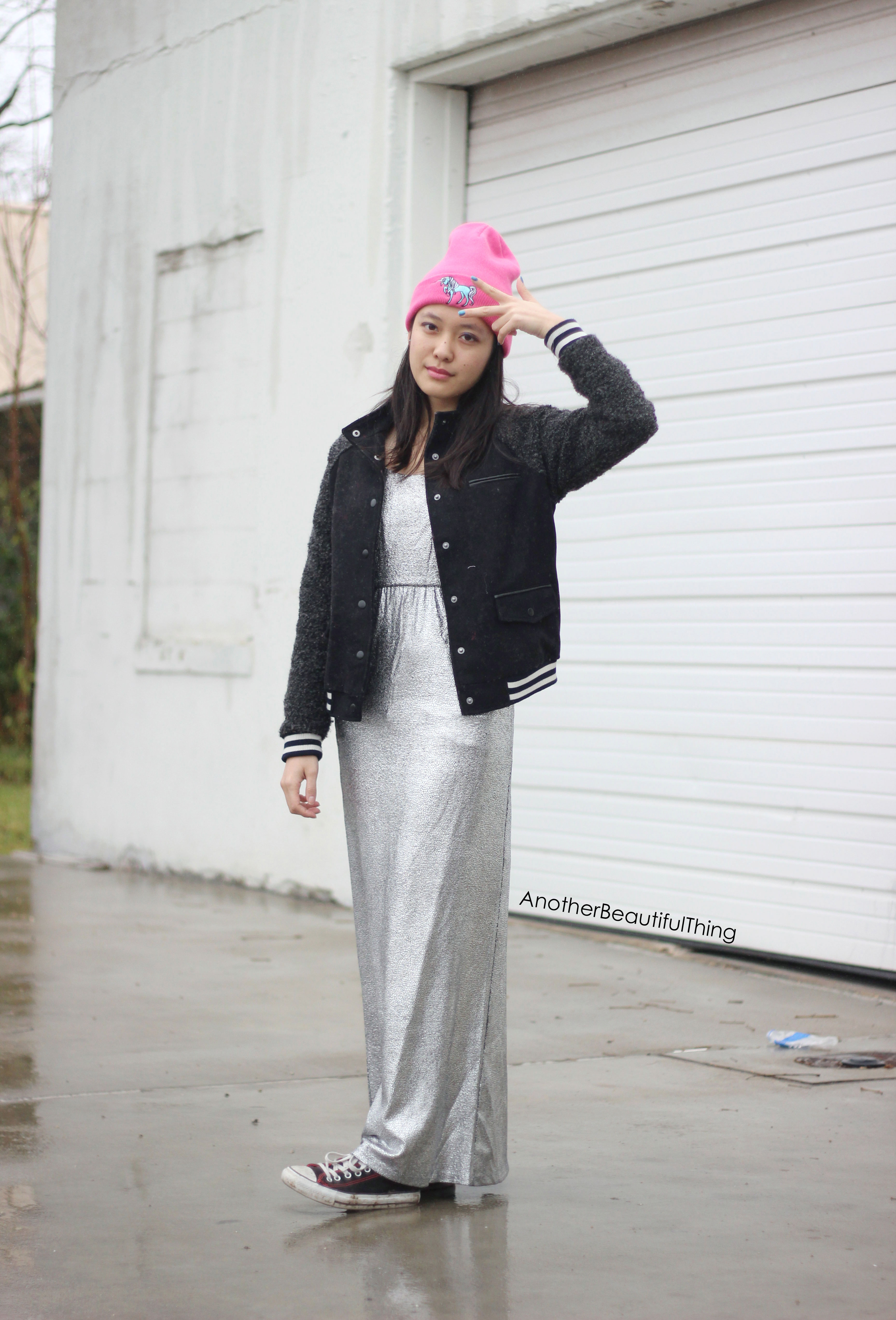 Silver sequin maxi gown with black converse and beanie