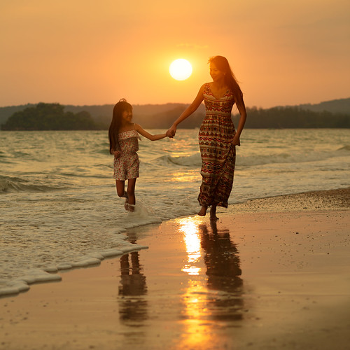 travel family sunset sea summer vacation two sky people woman cloud sun sunlight holiday playing love beach water girl beautiful beauty childhood smiling silhouette female sunrise mom asian fun thailand happy person evening coast sand holding child adult background daughter young mother lifestyle happiness running parent together thai tropical concept krabi aonang
