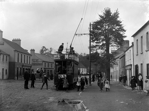 A street scene in Cork with tram and passengers!