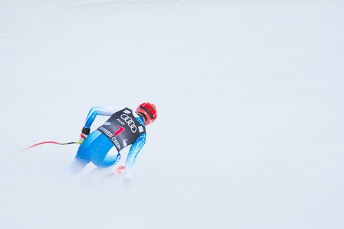 A skier racing to the finish line.