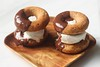 Donut ice cream sandwiches dunked in chocolate sauce
