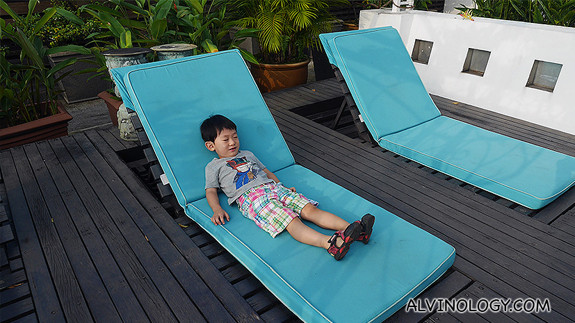Sunbathe on a deck chair at the rooftop