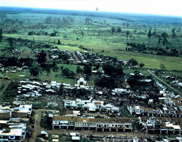 AN LOC 1972 - The center of town ravaged by battle. Note the Cobra flying low level high in the center