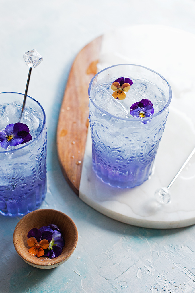 Fleur Collins Cocktail--St. Germain and Creme de Violette lend a floral twist to the bright and bubbly Tom Collins cocktail.
