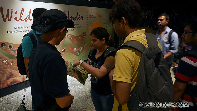 OUr super helpful guide giving guidance to some lost tourists at the Night Safari