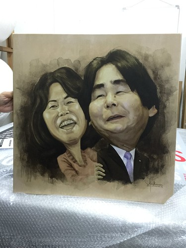 Digital painting couple caricatures of Mr & Mrs Ohshiro for Enagic Singapore Year End Party 2014