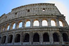 baptistery(0.0), ancient greek temple(0.0), roman temple(0.0), monument(0.0), dome(0.0), amphitheatre(1.0), ancient roman architecture(1.0), arch(1.0), ancient history(1.0), historic site(1.0), landmark(1.0), architecture(1.0), ancient rome(1.0), facade(1.0), triumphal arch(1.0),