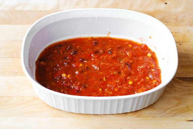 Put salsa on the bottom of the white baking dish