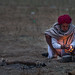 Marwari Camel Trader lights the cigarette in the Pushkar Camel Fair by anthony pappone photography