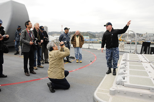 YOKOSUKA, Japan - Cmdr. Joshua Stewart, executive officer of the Ticonderoga-class guided-missile cruiser USS Shiloh (CG 67), explains the vertical launch systems and aegis weapons systems to media representatives during a tour.