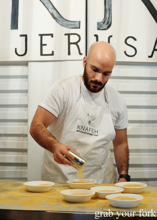 Adding the secret crumb topping at Knafeh, North Strathfield