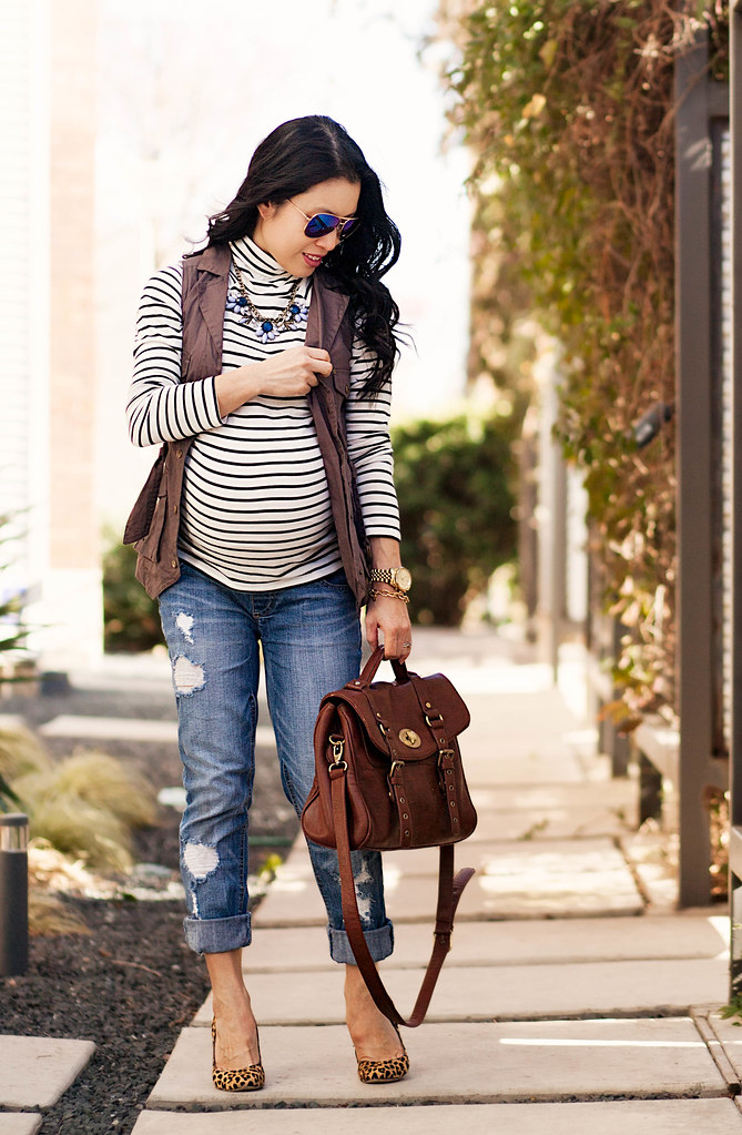 https://cuteandlittle.com | petite fashion blog | maternity | blue mirrored aviators, striped turtleneck, military utility vest, motherhood maternity distressed boyfriend jeans, leopard pumps | outfit