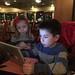 Scott and Elaine focused on Scott's iPad after dinner