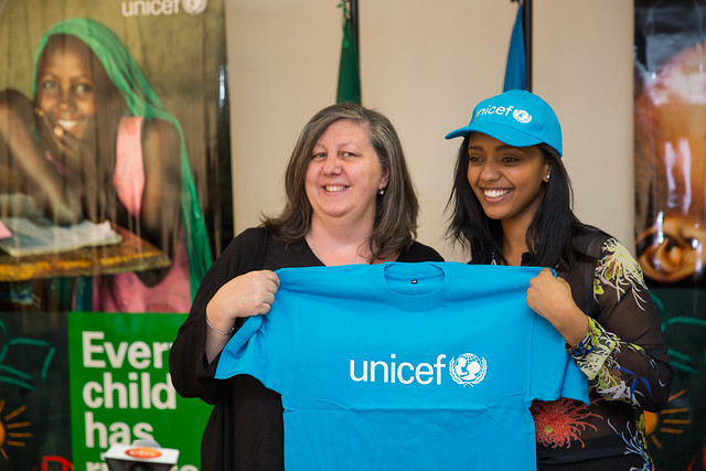 Abelone Melese and Patrizia DiGiovanni, Acting Representative for UNICEF Ethiopia hold a UNICEF T-shirt to officiate Abelone's new title.