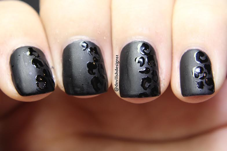 shiny black and matte black leopard print nail art