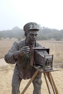 Shown here is a statue of Surfmen John T. Daniels of the Kill Devil Hills Life-Saving Service, predecessor of the modern day Coast Guard.  Daniels took the historic photo of the first flight of the Wright Flyer.