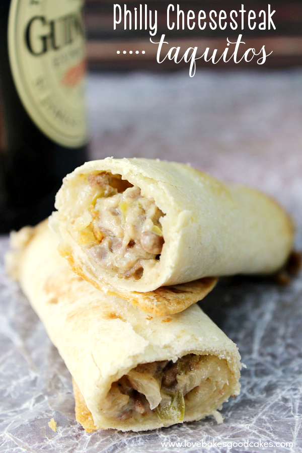 Philly Cheesesteak Taquitos with a bottle of Guiness.