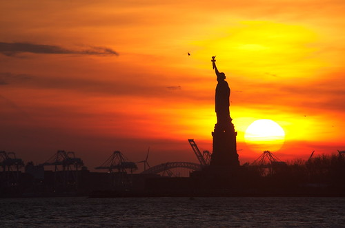 sunset statue ferry liberty south of