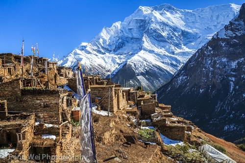 travel nepal color tourism horizontal landscape asia village outdoor scenic tibetan remote annapurnacircuit annapurna himalayas prayerflag gyaru gandaki annapurnaii ghyaru annapurnaconservationarea