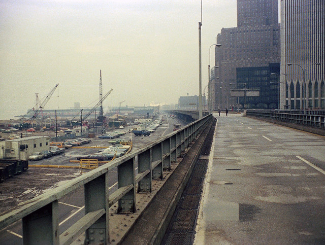 Lower Manhattan in the good old days. Looking up the abandoned West Side Highway in front of the World Trade Center. West Street, Battery Park City landfill and abandoned Hudson River piers at left. New York. March 1975