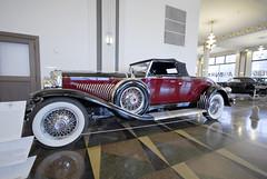 touring car(0.0), cadillac v-16(0.0), automobile(1.0), wheel(1.0), vehicle(1.0), automotive design(1.0), duesenberg model j(1.0), auto show(1.0), antique car(1.0), vintage car(1.0), land vehicle(1.0), luxury vehicle(1.0), convertible(1.0), motor vehicle(1.0), classic(1.0),