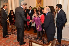 U.S. Secretary of State John Kerry meets with U.S. Ambassador to India Rich Verma and his family, at the Ambassador's swearing-in ceremony at the U.S. Department of State in Washington, D.C., on December 19, 2014. [State Department photo/ Public Domain]