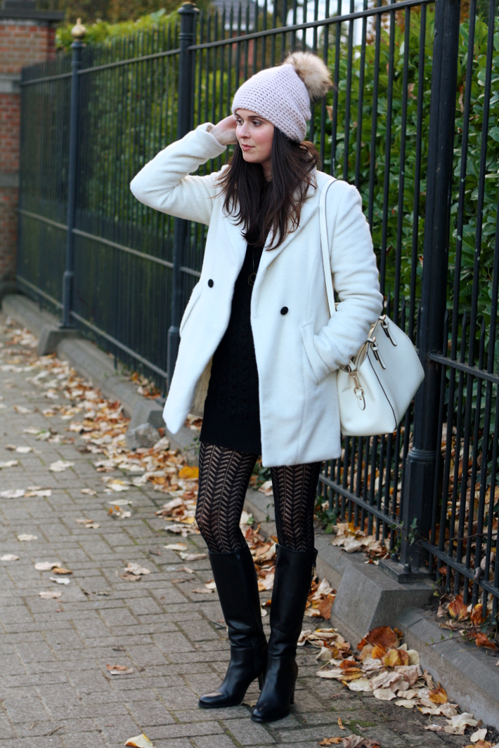 white winter coat pom pom hat tall boots