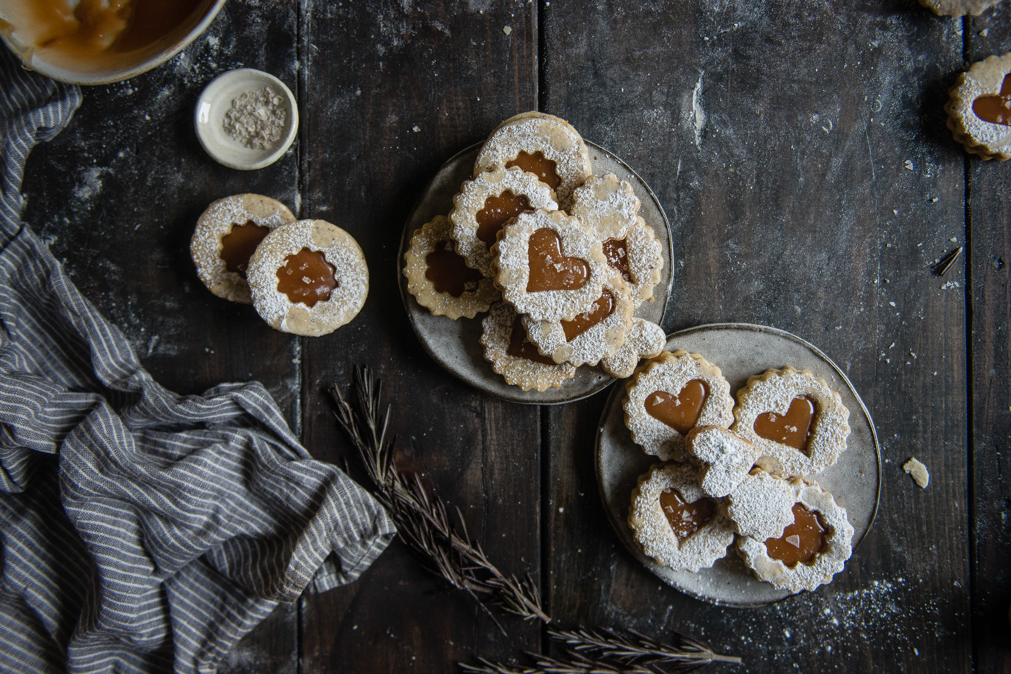 rosemary-hazelnut linzer cookies with salted caramel filling.