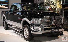 automobile(1.0), automotive exterior(1.0), pickup truck(1.0), wheel(1.0), vehicle(1.0), truck(1.0), auto show(1.0), ram(1.0), grille(1.0), bumper(1.0), land vehicle(1.0), motor vehicle(1.0),