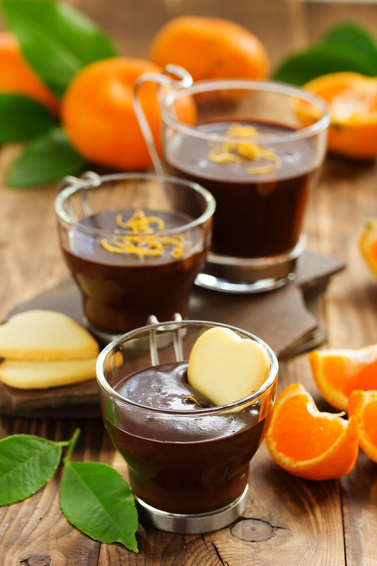 Chocolate dessert with oranges in a glass.
