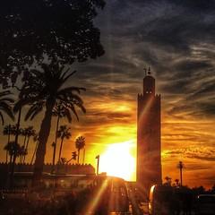 Marrakech's iconic Katoubia Mosque minaret at sunset.