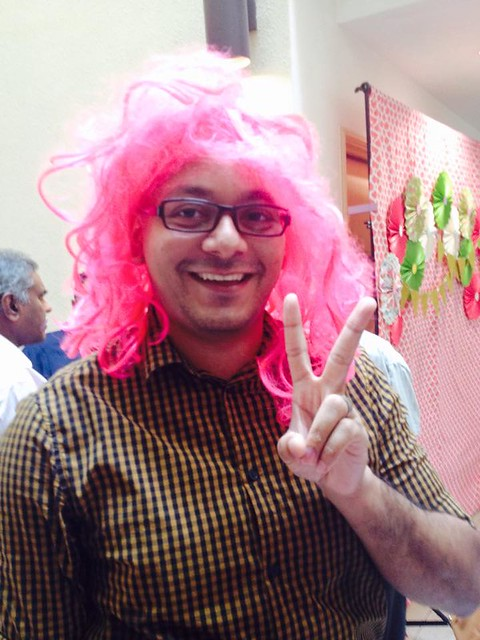 Nathan wearing a pink wig