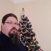 A beadwork Xmas tree in my beard in front of the family Xmas tree by rjw1